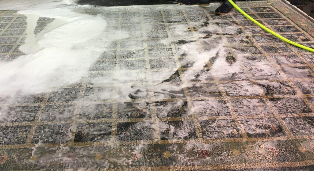 Rinsing wool rug